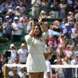 Marion Bartoli en larmes lors de son retour à Wimbledon, lors d'une petite cérémonie qui lui rendait hommage, ainsi qu'à Elena Baltacha, la joueuse britannique décédée le 4 mai, au All England Lawn Tennis and Croquet Club de Wimbledon, le 24 juin 2014