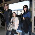 Courteney Cox, son petit ami Johnny McDaid et sa fille Coco arrivent à l'aéroport de LAX à Los Angeles pour prendre l'avion pour l'Europe, le 14 février 2014