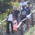 Bacary Sagna se promène avec sa femme Ludivine et leurs fils Kais et Elias sur la plage de Rio de Janeiro au Brésil le 26 juin 2014.