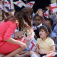 """""""Kate Middleton visite l'école maternelle Blessed Sacrament School à Islington, bénéficiaire du programme M-PACT Plus, le 1er juillet 2014."""""""