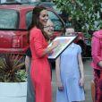 """""""La jolie Kate Middleton, la duchesse de Cambridge, visite l'école maternelle Blessed Sacrament School à Islington, bénéficiaire du programme M-PACT Plus, le 1er juillet 2014."""""""
