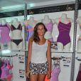 Laure Manoudou présente sa collection de maillots de bain 'Laure Manaoudou Design' lors d'un défilé à la Piscine de Boulogne-Billancourt le 2 Juillet 2014.
