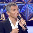 """Nagui sur le plateau de """"N'oubliez pas les paroles"""" sur France 2. Mardi 15 juillet 2014."""