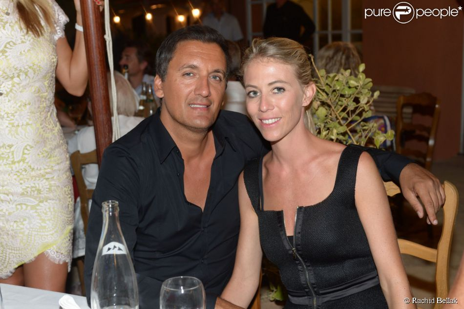 Danny Brillant et sa femme Nathalie au restaurant La Bouillabaisse à Saint-Tropez, à l'occasion d'un dîner organisé par Marcel Campion, le 6 août 2014.