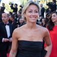 """Anne-Sophie Lapix - Montée des marches du film """"Pour une poignée de dollars"""" pour la cérémonie de clôture du 67e Festival du film de Cannes en 2014."""