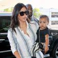 Kim Kardashian, son mari Kanye West et leur fille North prennent un vol à l'aéroport de Los Angeles. Le 1er septembre 2014.