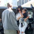 Kim Kardashian, Kanye West et leur fille North arrivent à l'aéroport de Los Angeles. Le 1er septembre 2014.