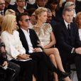 Charlize Theron, spectatrice star du défilé haute couture Christian Dior à Paris. Le 7 juillet 2014.