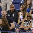 Thierry Henry, sa compagne Andrea Rajacic, Hugh Jackman, Anna Wintour et Mirka Federer assistent au match opposant Roger Federer à Gaël Monfils lors de l'US Open. New York, le 4 septembre 2014.