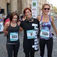 """Nathalie Péchalat, Fauve Hautot et Sandrine Retailleau - Course """"La Parisienne 2014"""" pour la lutte contre le cancer, au Champs de Mars à Paris, le 14 septembre 2014."""