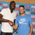 Usain Bolt et Oscar Pistorius lors d'une conférence de presse du meeting Areva à Paris, le 6 juillet 2011