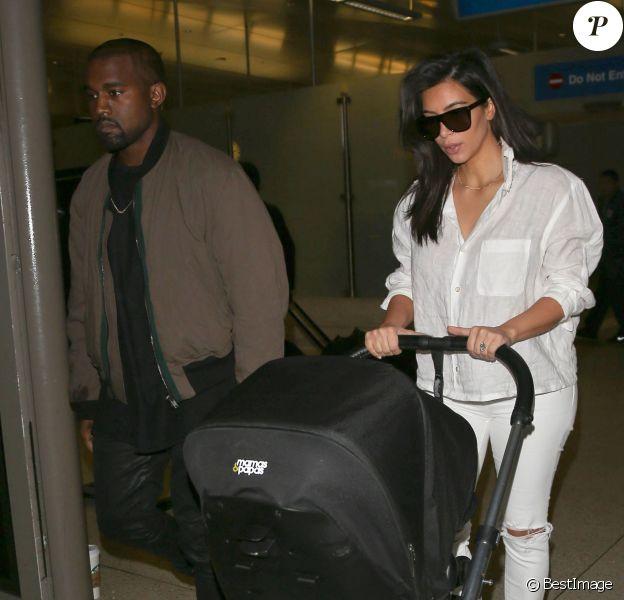 Kanye West, Kim Kardashian et leur fille North arrivent à l'aéroport de Los Angeles, en provenance de Brisbane. Le 16 septembre 2014.