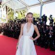 """Natasha Poly - Montée des marches du film """"Pour une poignée de dollars"""" pour la cérémonie de clôture du 67e Festival du film de Cannes – Cannes le 24 mai 2014"""