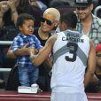 Amber Rose et son fils Sebatian, issu de son mariage avec Wiz Khalifa, supporters de Nick Cannon lors d'un match de basket caritatif à Los Angeles, le 21 septembre 2014. Le lendemain, elle se séparait de Wiz ; le surlendemain, elle demandait le divorce.