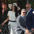George Clooney et sa femme Amal Alamuddin (en Stella McQueen) quittant l'hôtel Cipriani pour se rendre au palais de Ca Farsetti à Venise, le 29 septembre 2014 pour leur mariage civil à la mairie de Venise qui va officialiser la cérémonie de samedi soir.