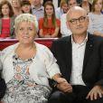 """L'actrice Mimie Mathy et son mari Benoist Gérard - Enregistrement de l'émission """"Vivement Dimanche"""" à Paris le 2 octobre 2013."""