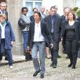 Nicole, fille de Marc Galabru, et un de ses petits-fils - Obsèques de Marc Galabru, le frère cadet de Michel Galabru, médecin, homme de lettres et de théâtre, en l'église Saint-Vincent-du-Bousquet-d'Orb, le 14 octobre 2014.