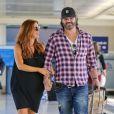Poppy Montgomery au côté de son époux Shawn Sanford, à l'aéroport LAX de Los Angeles, le 10 juillet 2014