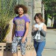 Redfoo des LMFAO se promène avec une jolie brune dans les rues de West Hollywood, le 13 novembre 2014