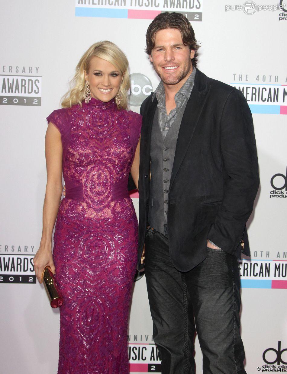 """Carrie Underwood et son mari Mike Fisher lors de la cérémonie annuelle des 40e """"American Music Awards"""" à Los Angeles, le 18 novembre 2012."""