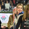 La princesse Caroline de Hanovre et Charlotte Casiraghi lors de l'épreuve Style & Sport Competition for AMADE au troisième jour du Gucci Paris Masters à Villepinte le 6 décembre 2014