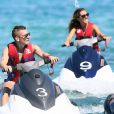 Lucas Digne et sa compagne Tiziri lors d'une randonnée à jet-ski dans le Golfe de Saint-Tropez, le 17 juillet 2014