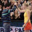Rory McIlroy et Caroline Wozniacki complices lors d'une exhibition au Madison Square Garden à New York le 5 mars 2012. Après près de 3 ans de relation, le couple a décidé en mai 2014 de se séparer alors qu'il se préparait à se marier.