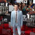 Drake Bell arrivant à la soirée des MTV Movie Awards 2014 au Nokia Theatre à Los Angeles, le 13 avril 2014.