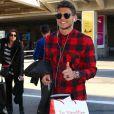 Rayane Bensetti arrive à l'aéroport de Nice avant une représentation dans le cadre de la tournée Danse avec les stars, le 6 janvier 2015.