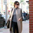 Kendall Jenner se rend chez le médecin à Beverly Hills, habillée d'un manteau beige sans manche Acne, d'un top à col roulé gris, d'un pantalon noir et de bottines Alexander Wang (modèle Anouck). Un sac Givenchy (modèle Pandora) et des lunettes de soleil accessoirisent sa tenue. Le 3 février 2015.