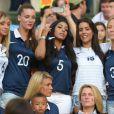 Fiona Cabaye, la compagne de LoÏc Rémy, Mazda Magui, Ludivine Sagna et Sandra Evra lors du match entre la France et l'Equateur au Maracana de Rio de Janeiro, le 25 juin 2014