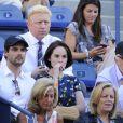 Michelle Dockery et son chéri John Dineen dans les gradins de l'US Open à New York en septembre 2013. Selon les médias britanniques, en février 2015, la star de Downton Abbey et son amoureux se sont fiancés.