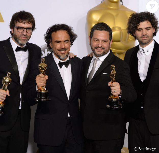 Nicolas Giacobone, Alejandro G. Inarritu, Alexander Dinelaris et Armando Bo - Press Room lors de la 87e cérémonie des Oscars à Hollywood, le 22 février 2015.