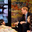Le prince William à la librairie Tatsuya, à Tokyo, le 28 février 2015, pour la promotion de produits britanniques lors de sa visite officielle au Japon.