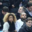 Layvin Kurzawa et sa compagne lors du match entre la France et le Brésil au Stade de France à Saint-Denis le 26 mars 2015