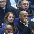 Thierry Henry et sa compagne Andrea Rajacic lors de la rencontre entre l'équipe de France et la sélection brésilienne, au Stade de France à Paris le 26 mars 2015