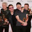 Le groupe U2 : Bono, Larry Mullen, The Edge et Adam Clayton - Cérémonie des Bambi Awards à Berlin le 13 novembre 2014.