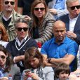 Gérard Holtz et sa femme Muriel Mayette, Eric Judor et sa compagne lors des Internationaux de France à Roland-Garros à Paris le 28 mai 2015 à Paris
