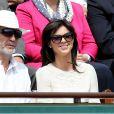 William Lowenstein, président de l'association SOS Addictions, et Caroline Barclay lors des Internationaux de France à Roland-Garros à Paris le 28 mai 2015 à Paris