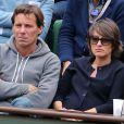 Le journaliste Pascal Humeau et sa compagne la journaliste Amandine Bégot (enceinte) concentrés - People au village des Internationaux de France de tennis de Roland Garros à Paris, le 29 mai 2015