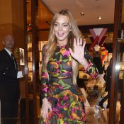 Lindsay Lohan : Souriante après les TIG, avec Naomi Campbell et Lewis Hamilton