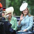 Catherine, duchesse de Cambridge, pour sa première activité royale après la naissance de la princesse Charlotte, Camilla Parker Bowles, duchesse de Cornouailles, et le prince Harry le 13 juin 2015 à Londres lors de Trooping the Colour, la parade annuelle en l'honneur de l'anniversaire de la reine Elizabeth II.