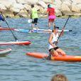 """Exclusif - Estelle Lefébure lors de la sixième édition du Waxx summer sup challenge à Bandol, le 4 juillet 2015. Estelle Lefébure, marraine de l'association """"Ninoo"""" pour enfants autistes, a tenu à participer à une course au profit du petit Edgar."""