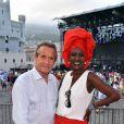 Jacky Ickx et sa femme Khadja Nin. Concert organisé le 12 juillet 2015 sur la place du palais princier à Monaco, avec Robbie Williams et Lemar, en clôture des célébrations des 10 ans de règne du souverain.
