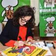 La dessinatrice Coco (Corinne Rey) lors de la Fête de l'Humanité 2015 dans le Parc de la Courneuve en région parisienne, le 13 septembre 2015