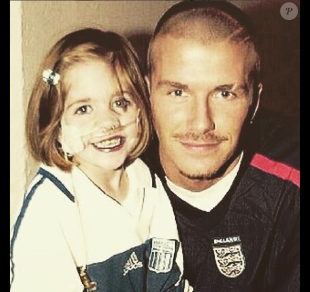 David Beckham et la petite Kirsty Howard, en 2002.