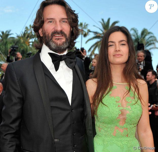 """Fréderic Beigbeder et sa femme Lara Micheli - Montée des marches du film """" Saint-Laurent"""" lors du 67e Festival du film de Cannes, à Cannes le 17 mai 2014"""