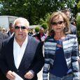 Dominique Strauss Kahn et sa compagne Myriam L'Aouffir dans les allées du tournoi de Roland-Garros, le 30 mai 2015.