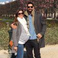 Nikola Karabatic et sa compagne Géraldine Pillet, enceinte de 8 mois, lors d'une promenade place des Vosges à Paris le 17 mars 2016. Leur enfant est attendu au mois d'avril.