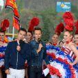 Laurent Luyat et Cyril Féraud sur le départ de la deuxième étape de la 103ème édition de la course cycliste du tour de France avec les danseuses du Moulin-Rouge le 3 juillet 2016 entre Saint-Lo et Cherbourg-en-Cotentin, en Normandie le 3 juillet 2016. . © Coadic Guirec / Bestimage